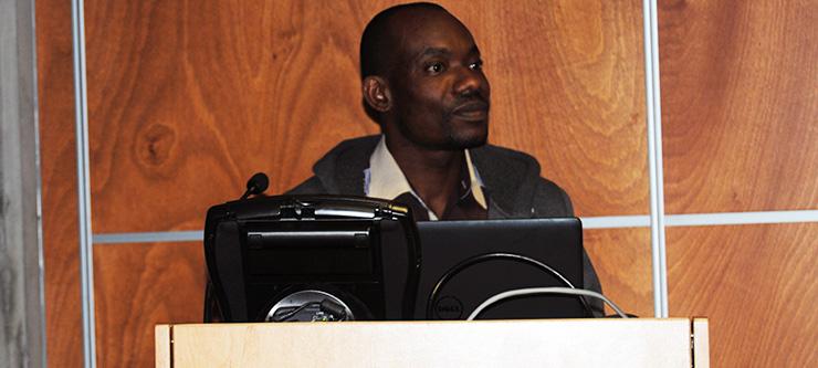 Mr Chris Ajonijebu presenting at the Research Symposium.